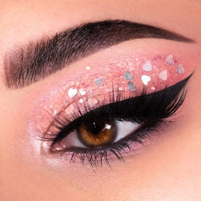 Valentine-inspired makeup in pink colors and glitter applications