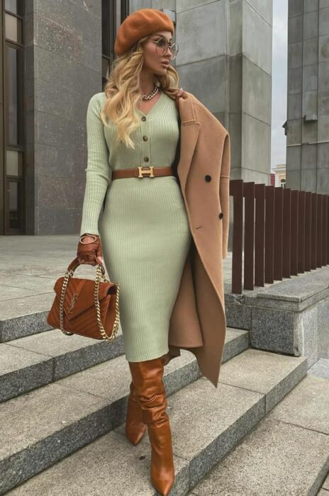 Victoria Fox wearing green pencil dress with camel-tone boots, bag, coat and beret