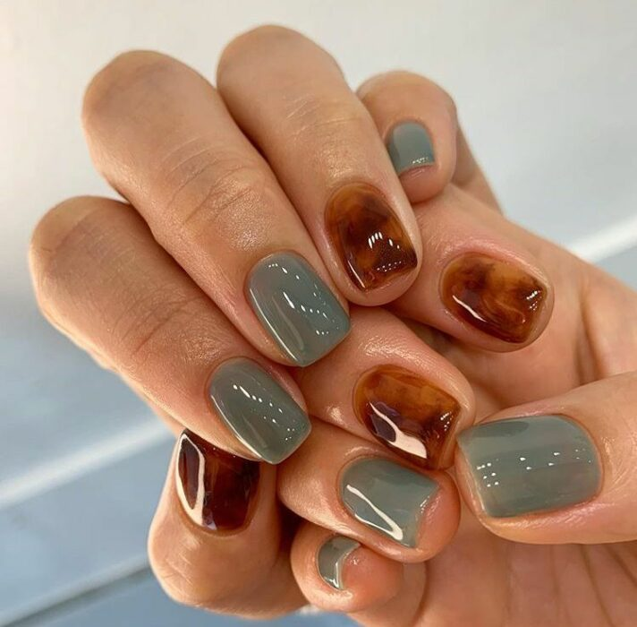 Manicure with tortoiseshell design on several fingers and the rest in an aqua tone