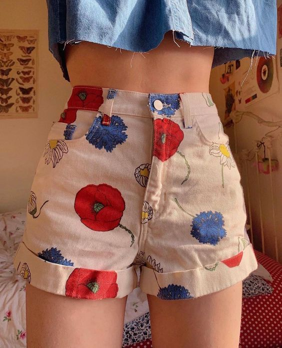 girl wearing short white shorts with blue and red flowers