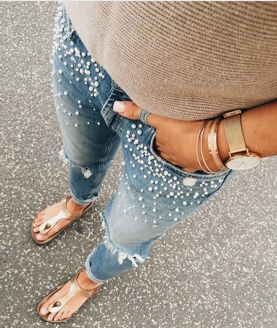 girl wearing ripped jeans decorated with pearls; ; 13 ways to save your ripped jeans and stay in style