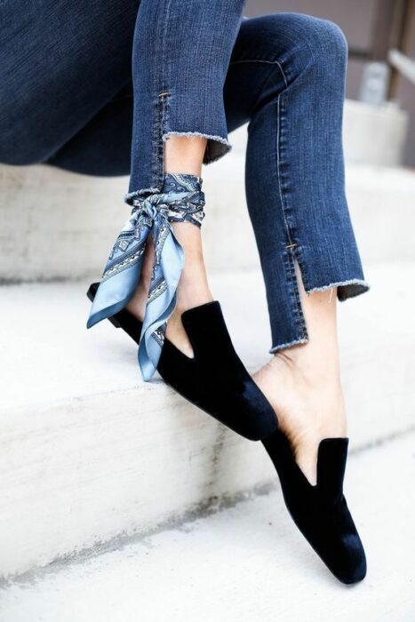 girl with torn jeans from the cuffs and a blue scarf; ; 13 Ways To Save Your Ripped Jeans And Stay Fashionable