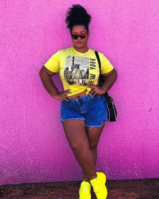 Girl in denim shorts and neon yellow top; 13 Outfits with neon tennis shoes to dazzle at every step