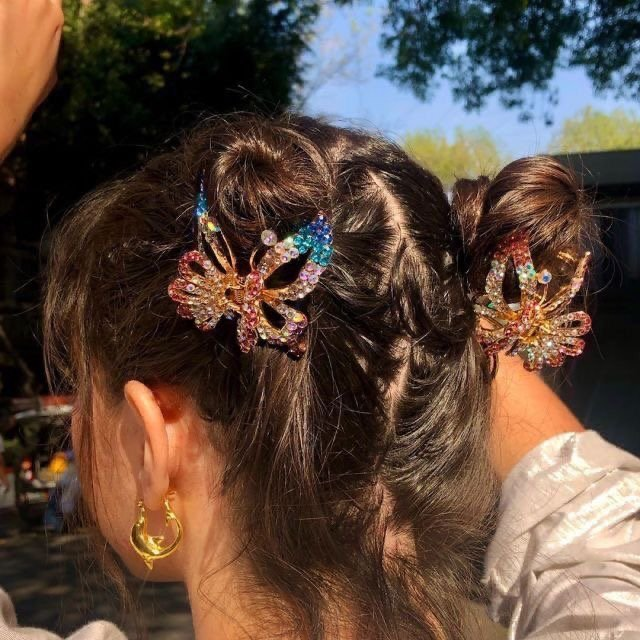 Girl with high double bun and butterfly clasps; 13 cute hairstyles to share on your Instagram stories