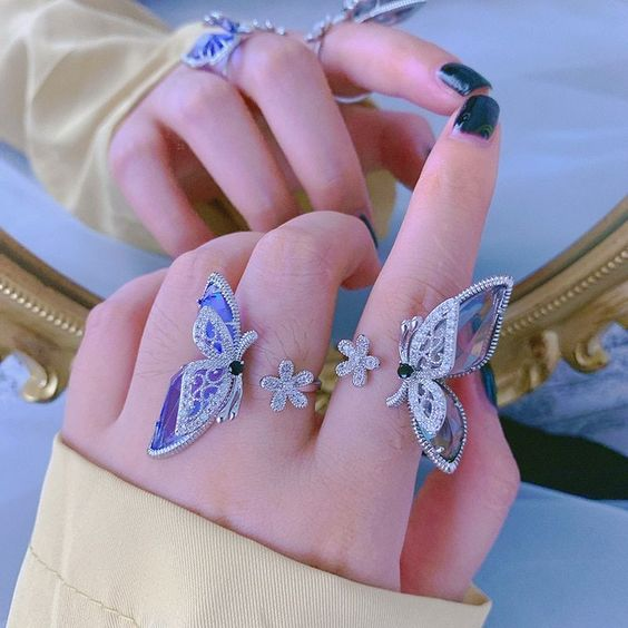Girl wearing a ring with butterflies