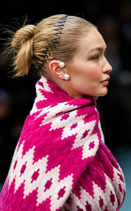 Gigi Hadid modeling a pink outfit with a zigzag headband