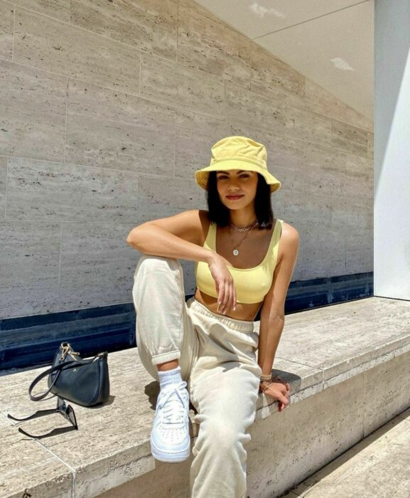 Girl wearing a bucket hat with her yellow outfit