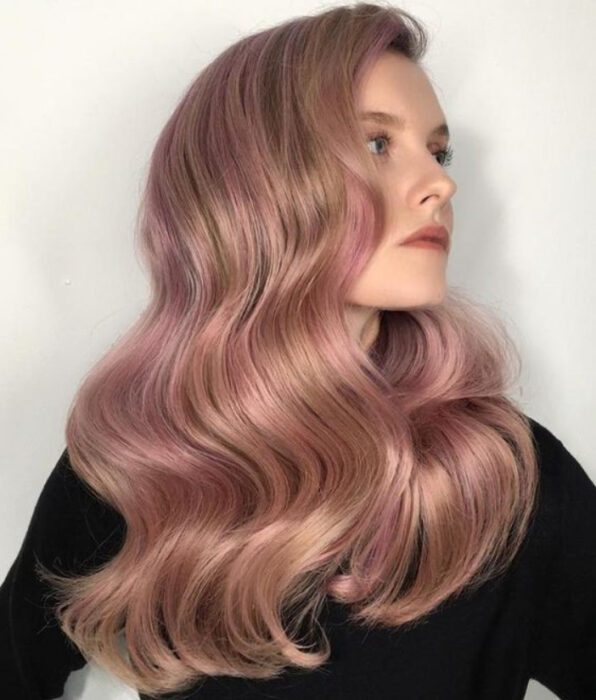 Girl with light brown hair, long wavy with 'Gold Pink Hair' dye