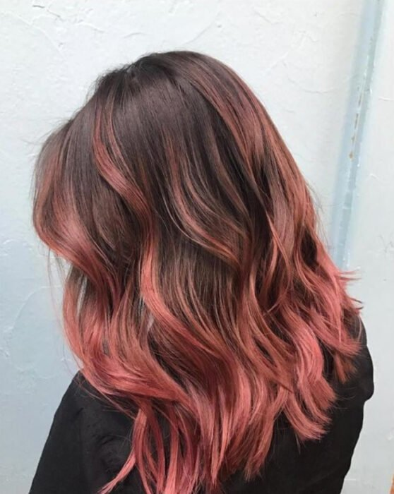 Girl with dark brown hair with medium hair and 'Gold Pink Hair' dye