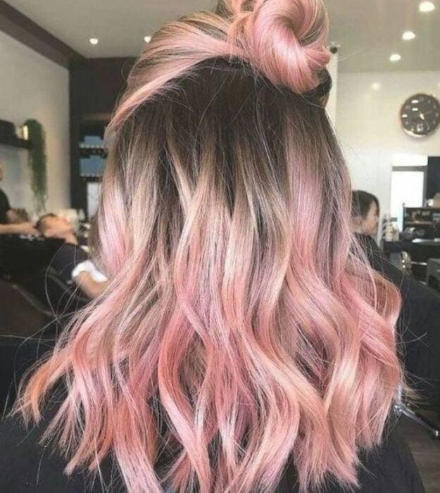 Girl with medium long wavy hair and 'Gold Pink Hair' dye