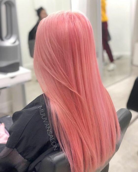 Girl with long, straight hair with 'Gold Pink Hair' dye