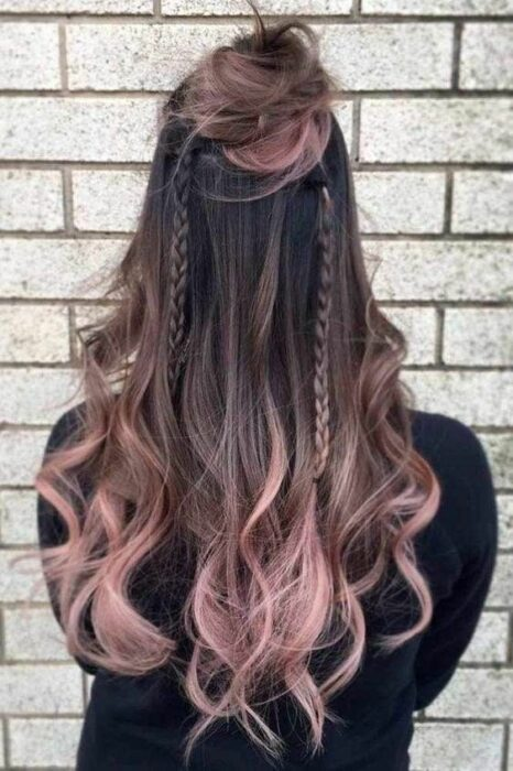 Girl with long, wavy, dark brown hair with 'Gold Pink Hair' dye