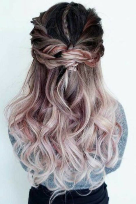 Girl with long wavy hair and half collected with 'Gold Pink Hair' dye