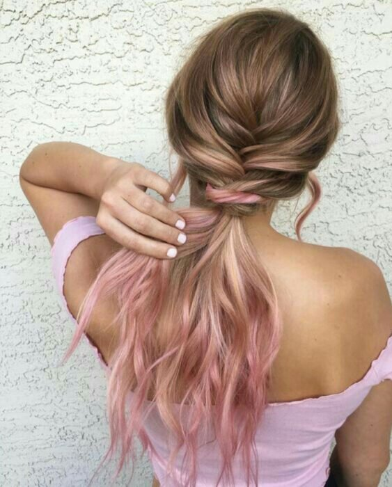 Girl with long wavy, light brown hair, collected and with 'Gold Pink Hair' dye