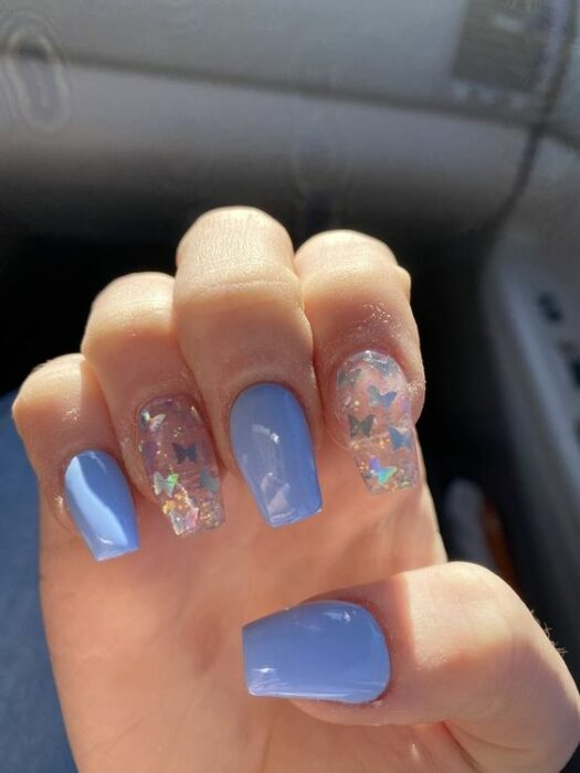 Manicure in sky blue color with translucent butterflies design; Ideas for aesthetic manicure