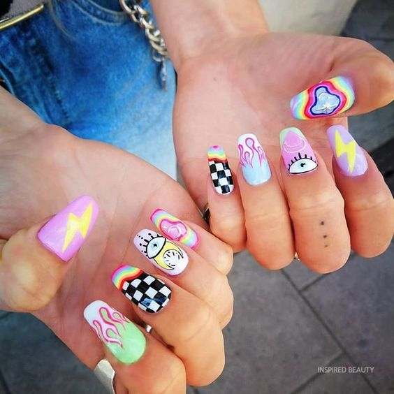 manicure with retro stickers in fluorescent tones; Ideas for aesthetic manicure