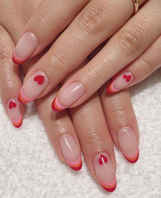 French style manicure in red and pink tones with heart decoration; Ideas for aesthetic manicure