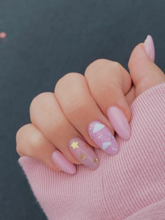 pastel pink manicure with background clouds; Ideas for aesthetic manicure