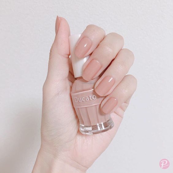 Pale pink manicure with gloss effect; Ideas for nude manicure
