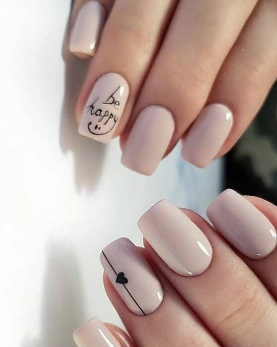 Manicure in nude tone with heart print in black tone; Ideas for nude manicure
