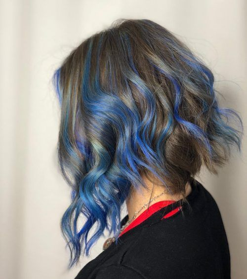 Girl with short hair with highlights in blue tones