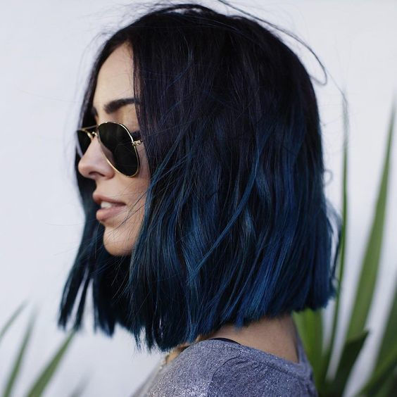 Girl with midi cut hair dyed in navy blue