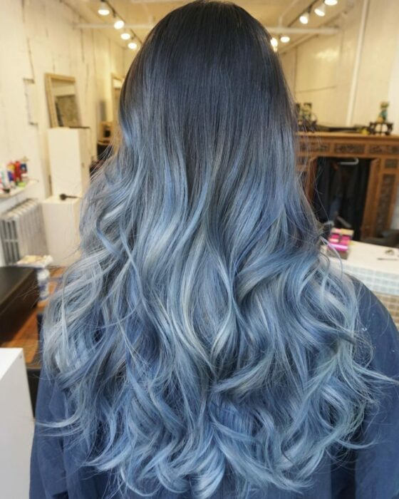 Girl showing her grayish blue hair with pastel sparkles