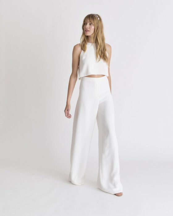 Girl wearing a white top and pants