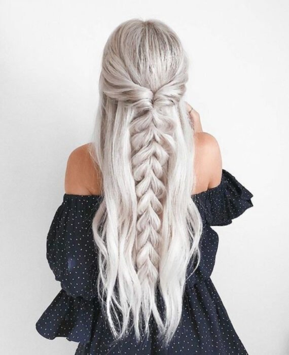 Girl with long, platinum hair with loose braid