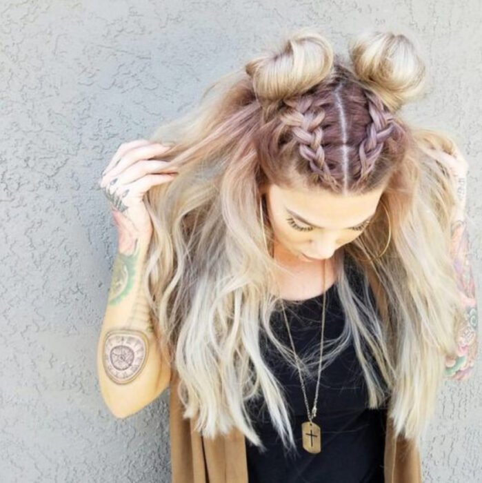 Blonde hair girl with two braids ending in buns