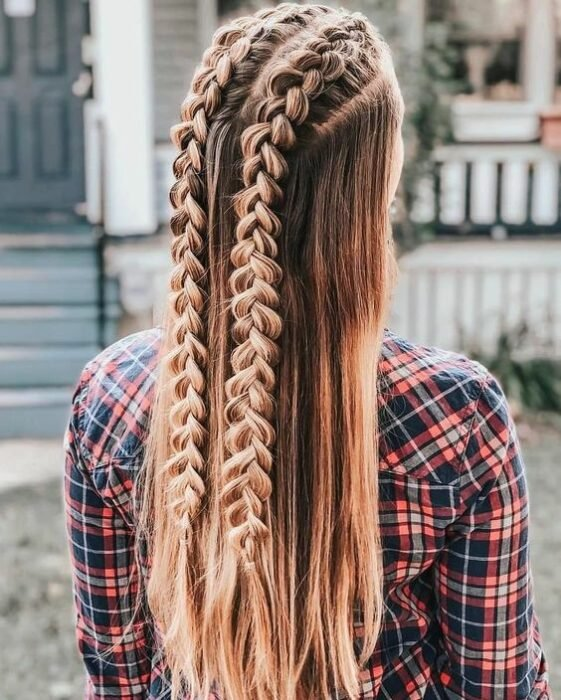 Long-haired girl with two braids starting from the top of the head