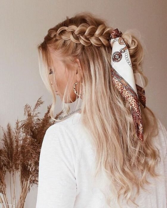 Girl with side braid decorated with a scarf