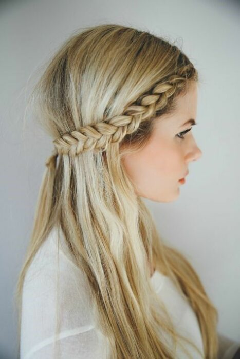 Blonde hair girl with braid crown that is attached below the nape