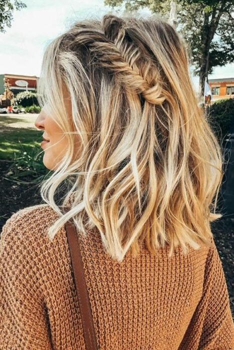 Short hair girl combed with a loose braid