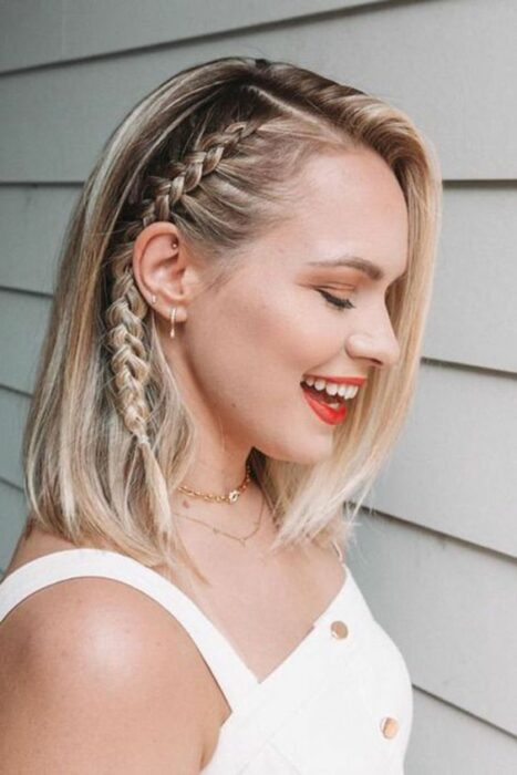Short blonde hair girl with side parting and braid attached from one side