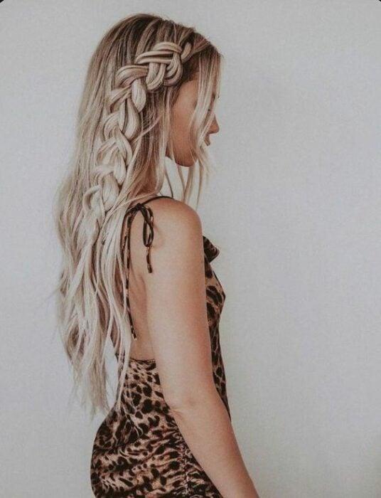 Long blonde hair girl with loose braid