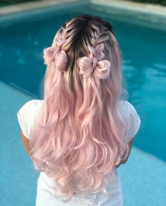 Baby pink hair girl, with braids that end in little buns