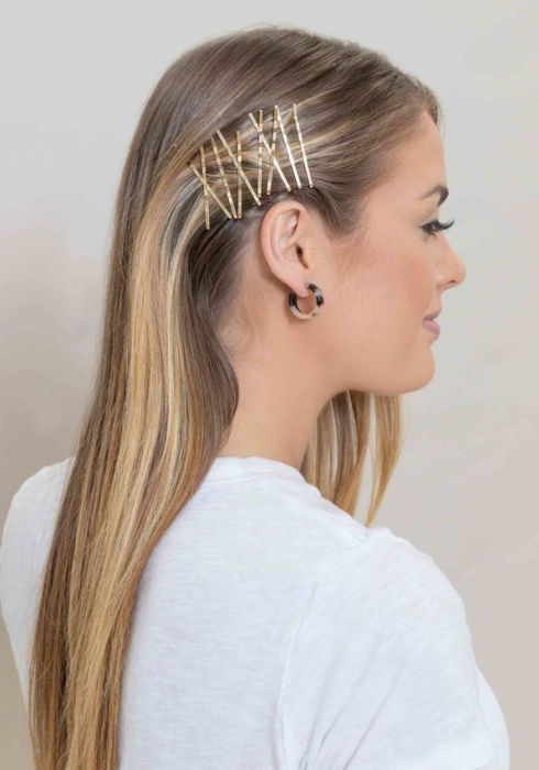 Girl with hair fastened with pins on the sides
