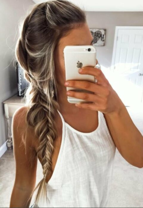 Girl with hair tied in a side braid