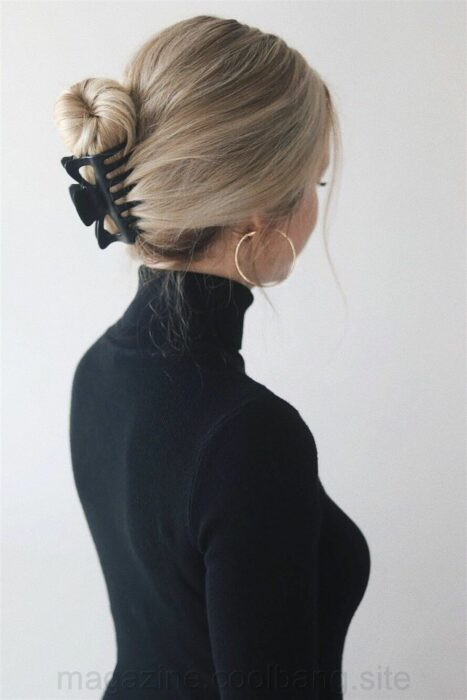 Girl with hair fastened with a black clamp