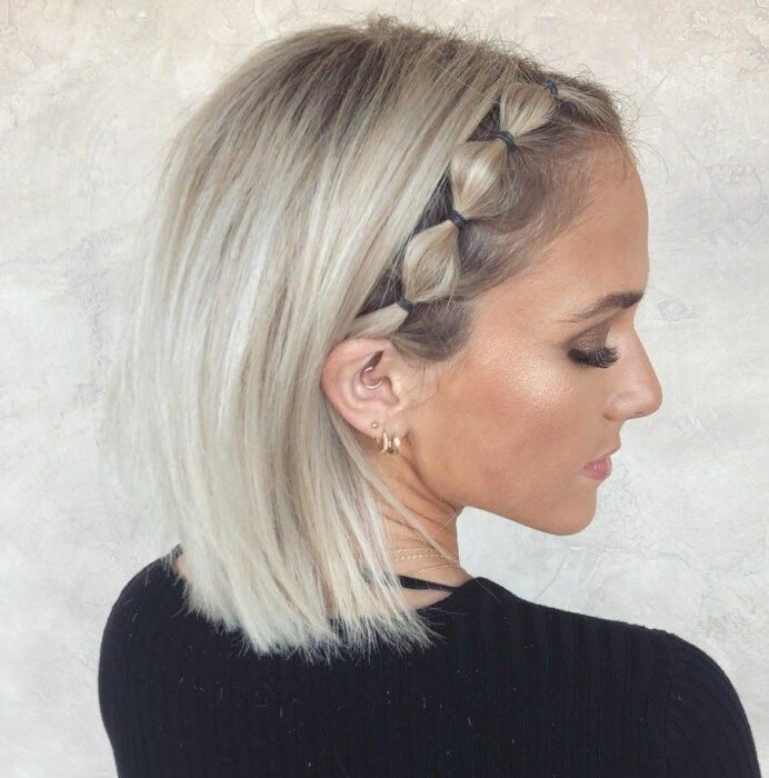 Girl with shoulder-length hair fastened in a bubble braid