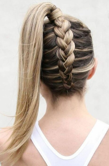 Girl with hair tied in a braid at the nape and a ponytail