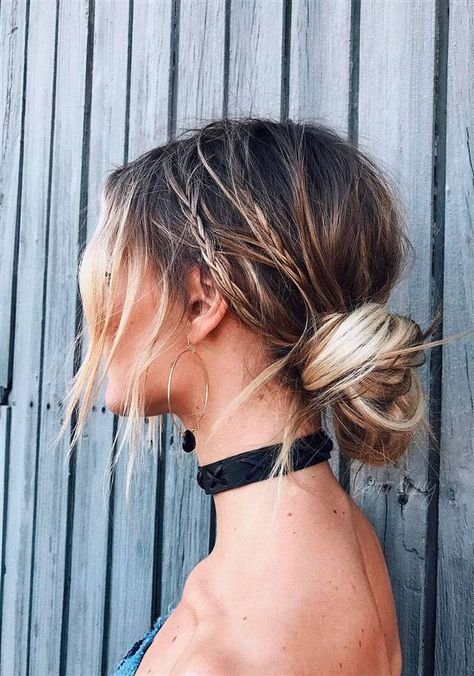 Girl with hair tied in a disheveled bun