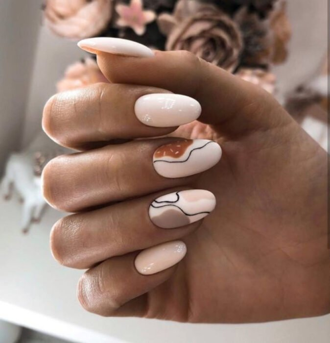 Beige base nails with coffee details and black lines