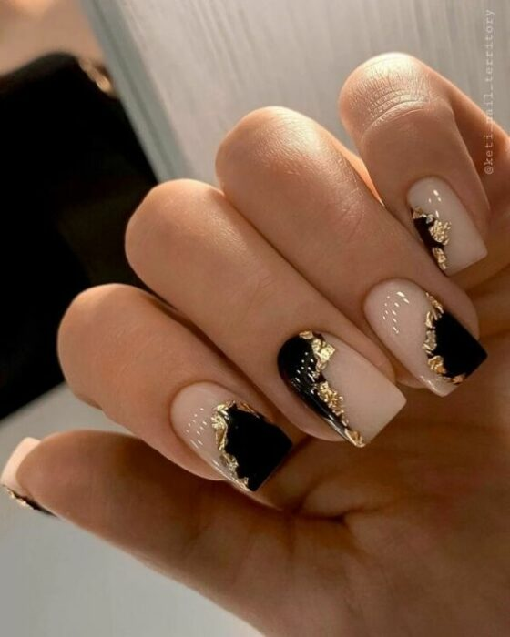 Nude nails with black and gold details