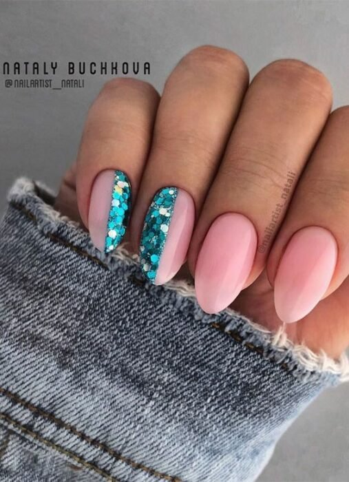 Pink manicure with metallic blue glitter details