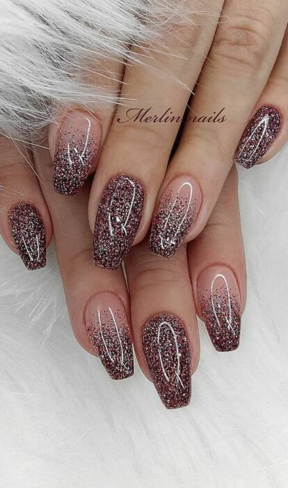 Nude background manicure with copper glitter details