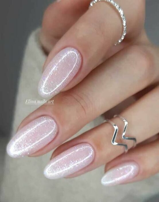 Manicure with glitter detail in pearl tone