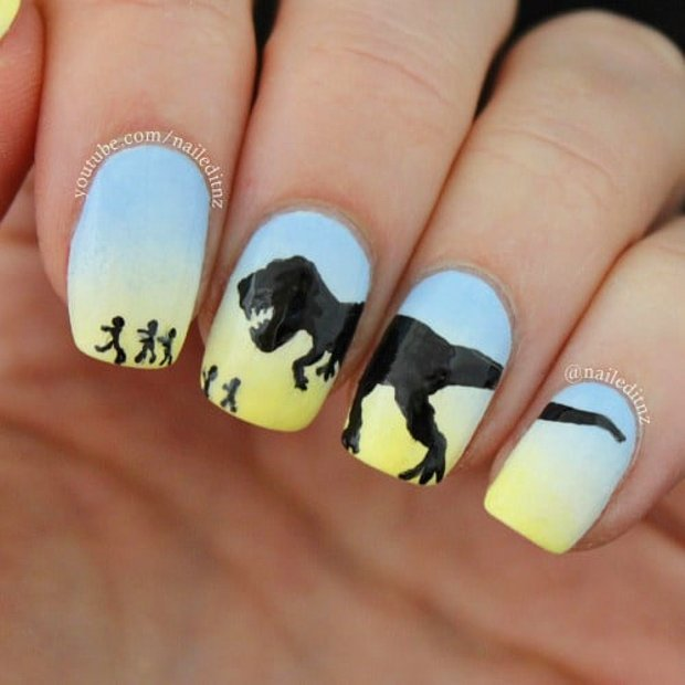 Girl with a dinosaur nail design in different colors