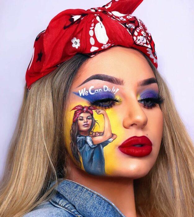 Chica con el rostro pintado con la chica we can do it